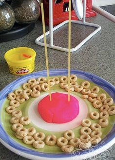 How many Cheerios can you stack? Fun & creative kids game using play-doh, uncooked spag. noodles & cheerios!