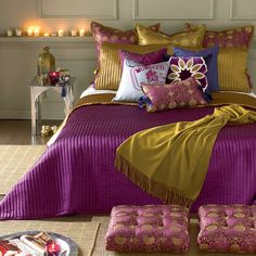 morrocan bedspread color combo - love this bright purple with the gold.  Keep the walls neutral so I don't blind myself when I wake up in the morning!