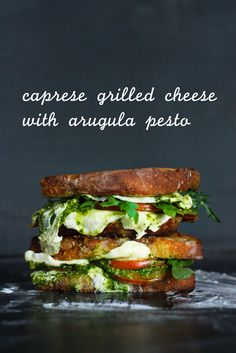 Melty Caprese Grilled Cheese with Arugula Pesto. The best, most flavorful grilled cheese ever!!! #grilledcheese