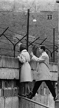 Built with barbed wire and concrete, the wall stretched for 31 miles, separated East and West Berlin as a cold war divide, preventing East Germans from crossing to the west. — ohoctopus.blogspot.com