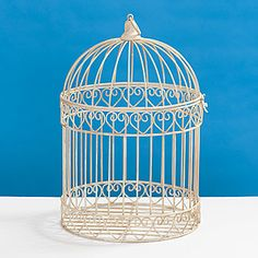 The Decorative Ivory Bird Cage Centerpiece has the look of small bird cage that can be filled with your decorating accents. The Black bird cage centerpiece is made of metal.