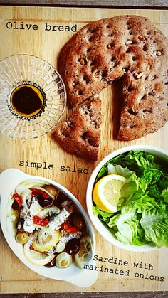 Homestead olive bread,   sardine with marinated onion and dried tomatoes and simple salad