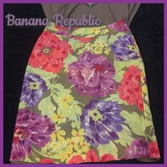Banana Republic floral pencil skirt Gorgeous skirt in perfect condition. Green silky liner underneath. Slit in back. 22 inches long, 15 inch waist. Size 4. There is a name label for the dry cleaners over the Banana Republic label but it can clearly be seen underneath. Skirt was just dry cleaned. Banana Republic Skirts Midi