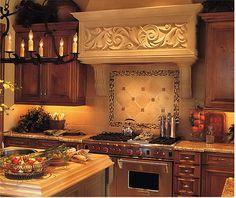 kitchen stone backsplash and gorgeous vent hood