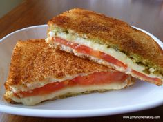 Pesto Grilled Cheese Sandwich: (with substitutions) Pesto vegenaise sliced tomatoes sliced light/skim mozzarella (or vegan version) Ezekiel flax sandwich bread optional: Tofurkey deli slices