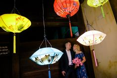 A Newlywed Couple Illuminated Against Colourful Silk Lanterns in Hoi An. #HoiAnEventsWeddings #HoiAn #VietnamBeachWeddings #Lanterns #Newlyweds