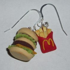 Burger and fries earrings, handmade using fimo clay.  http://www.judesjewels.co.uk/ourshop/prod_1883787-Burger-and-Fries-Earrings-Burgers-Chips-Sterling.html