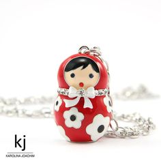 Matryoshka is a cult item of clothing, very popular Russian souvenir. The chain is very elegant and eye catchy. The pendant is enameled and decorated with crystals.