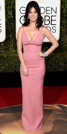 Katy Perry in Prada. For me something is just off and I think if the straps were wrought in a few inches it would have helped. It would also help lift a support the girls