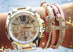 Boyfriend watch and delicate pink stack.