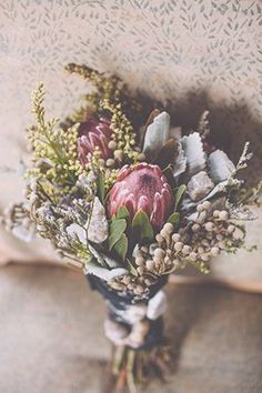 Proteas, dusty miller, and berries | Photo by Mackensey Alexander | Floral design by Ivory and Beau