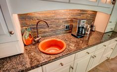 wet bar in the kitchen is the perfect place for a wine or coffee bar. www.jamesriverconstruction.com
