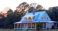 Oldfield, in the Low Country of South Carolina, designed by Helga Lilley of Gorgeous Green Home Design in Okatie, South Carolina.    pros.marvin.com/window-door-ideas/architectural-windows-d...