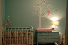 The Baby's Crib and Personalized Jeweled Tree Wall Decal: I decorated an owl, tree and nature themed nursery without working with a huge budget or a huge room. Even so, the design works great for us. I knew that
