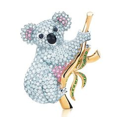 Tiffany & Co.Koala made from White-Pink Diamonds and Black Onyx with Gold and (either Emerald or Peridot) leaves