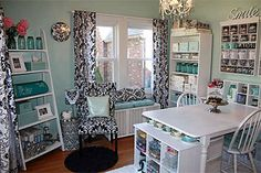 A craft room with teal, black and white decor, and plenty of storage
