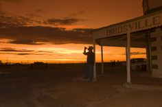 Stockman at sunset at the Birdsville Hotel, Queensland, Australia. Image by Danielle Lancaster Savanna Grassland, Clear Night Sky, Ao Nang Beach, Railay Beach, Destinations, Channel, Old Pub, Cool Rocks, Rock Pools