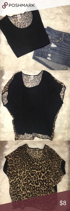 Black and cheetah print shirt Black on the front and shear cheetah print on the back. Size XS but fits like a Small. A little cropped/high low style. Tops Blouses
