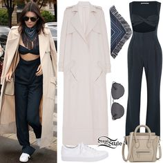 Kendall Jenner was spotted arriving at L'Avenue in Paris today wearing an Alessandra Rich Pinstriped Silk-Blend Jumpsuit ($2,745.00) a Sally LaPointe Duster Trench Coat ($2,950.00), her Céline Nano Luggage Tote ($2,250.45), a Derek Lam Midnight Multi Fringe Scarf ($225.00), Dior Technologic Sunglasses ($540.00) and a pair of Kenneth Cole Kam Sneakers ($59.99).