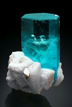 Aquamarine and Albite - Shigar Valley, Skardu District, Baltistan, Gilgit-Baltistan (Northern Areas), Pakistan.Photo: stonetrust  Geology Wonders