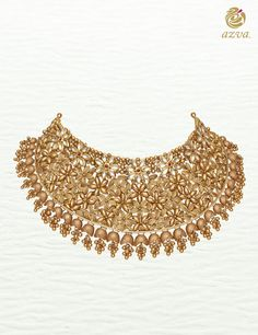 Azva handcrafted gold hachoker with kundan flowers and intricate handcrafted design. #Goldjewellery #luxury #style