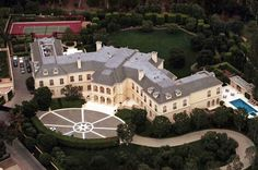 """""""Located in Holmby Hills, California, this is the 56,500 square foot mega mansion of the late Aaron Spelling. Widow, Candy, sold it to billionaire heiress Petra Ecclestone in 2011 for $85 million."""