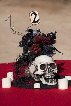 Skull centre pieces at a Satanic wedding   Misfit Wedding