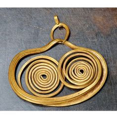 """Macedonian earring.  Jewelry in ancient Greece was mostly worn for public appearances or on special occasions. It was mostly worn by women to show off their wealth, social status, and beauty. Some jewelry was believed to give the wearer protection from the """"Evil Eye,"""" or give the owner supernatural powers, while other pieces had a religious symbolism. Older pieces of jewelry were dedicated to the Gods. The largest production of jewelry in these times came from Northern Greece and Macedonia."""