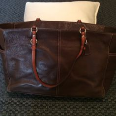 Coach 100% leather Tote Bag Used with minimal wear on bottom corners. One snap missing on side pocket (original snap included for repair). Beautiful pink stitching. Coach Bags Totes
