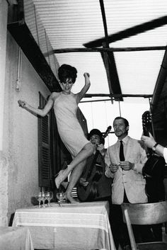 Raquel Welch dancing on tables with Marcello Mastroianni, 1966.