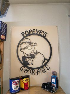 Excited to share this item from my shop: Popeye's Garage metal wall sign Dog Lover Gifts, Gift For Lover, Olaf Drawing, Scrap Material, Plasma Cutting, Wine Bottle Holders, Garden Signs, Dog Coats, Metal Walls