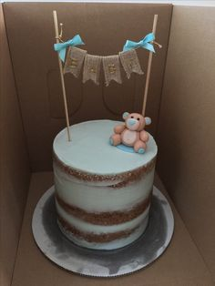 Blue naked cake with baby banner and fondant teddy bear made in Hawaii by Play Date Cupcakes.