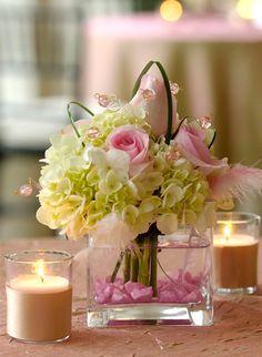 a romantic arrangement of white hydrangeas & soft pink roses