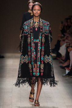 """VALENTINO:  Maria Grazia Chiuri and Pierpaolo Piccioli decided to take """"Opera"""" as their inspiration. This lead to a mishmash of styles folded together like a costume designer on acid.    For an opening outfit, the look struck Native American chords, mixed with Italian drama and Mediterranean style embroidery."""