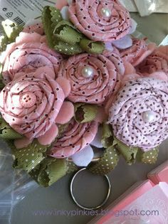Great tutorial by Erica Clark of InkyPinkies for fabric flower key chains.  These were made with Twitterpated Fabric from Stampin' Up.