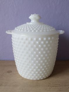 I have this one and use it as my sugar canister Vintage milk glass