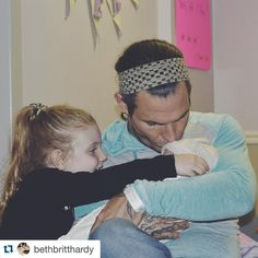 """Former WWE Superstar Jeff Hardy, alongside his daughter Ruby, sweetly cradling his newborn daughter Nera Quinn. """"And then we were four. 12-31-15 #NeraQuinnHardy ❤️❤️❤️❤️"""" - Beth Britt Hardy"""