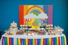 Dessert table at a rainbow birthday party! See more party planning ideas at CatchMyParty.com!