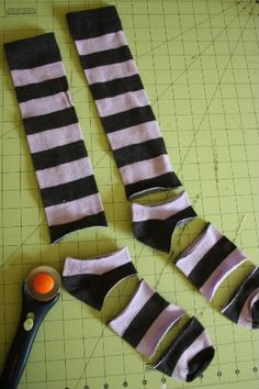 Baby leg warmers.. i am going to start picking up all the cute holiday knee socks on clearance after the holidays and start making these for nxt year. Ohh fun, and i will have to check ross, i think i have seen hello kitty ones.. yah, she can have hello kitty legwarmers for wayy less.