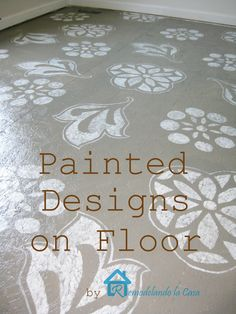 Diy - Painted Designs on Floor:  She painted the subfloor of OSB by filling in holes, sanding, making small groves so it looks a bit like wood planks, paint, homemade stencils using tracing paper transferred to contact paper using an x-acto knife, then fi