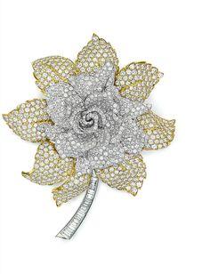 A diamond and gold flower brooch, by David Webb