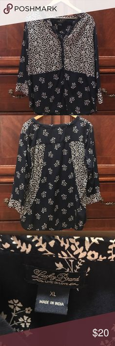 Lucky Brand Women's Tunic Top Navy and cream printed women's Lucky Brand tunic top. V-neck with three buttons down the front of the shirt and also buttons on the sleeves. Cream floral print on navy material. Lucky Brand Tops Tunics