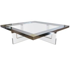 Large Lucite, Chrome & Brass Coffee Table | From a unique collection of antique and modern coffee and cocktail tables at https://www.1stdibs.com/furniture/tables/coffee-tables-cocktail-tables/
