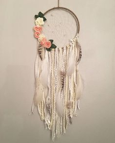 Hand made floral dream catcher . In picture shown dream catcher is 8inches. Second picture is a 10inch Dream catcher with a 8inch ring laying on it. If you would like a different size please select the size when purchasing . For custom orders message me . To see more of my Dream