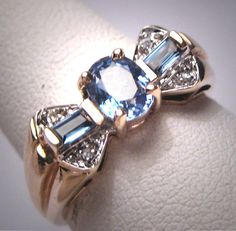 Vintage Sapphire Diamond Wedding Ring Retro by AawsombleiJewelry. Only 1 left! Antique vintage, estate jewelry, ceylon blue, fine jewelry, anniversary band, gemstone ring, bow, victorian jewelry, yellow gold, emerald cut, gift idea, buy it now.