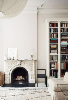 ornate fireplace white white walls and tall ceiling. / sfgirlbybay