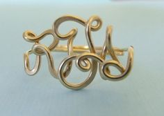 Handcrafted Monogram Ring in 14k gold from CrystalBlue07 (via Etsy).