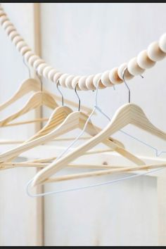 Fuers Heim Snake clothes rail - This hanging wooden bead garland was designed as clothes line or wardrobe rail. Handmade in Germany from 40 beech wood balls.