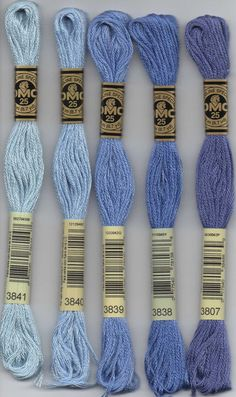 DMC six-stranded embroidery floss 3853, 3854, 3855, 3801, 3831, 3832, 3833 orange bright coral red and raspberry