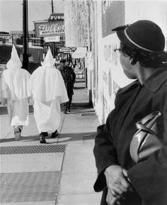 Taken in the mid 1950's in Alabama, this image shows the intimidation and separation that was very prominent between blacks and whites.